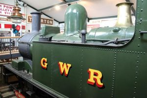 A green steam engine with GWR painted on its side