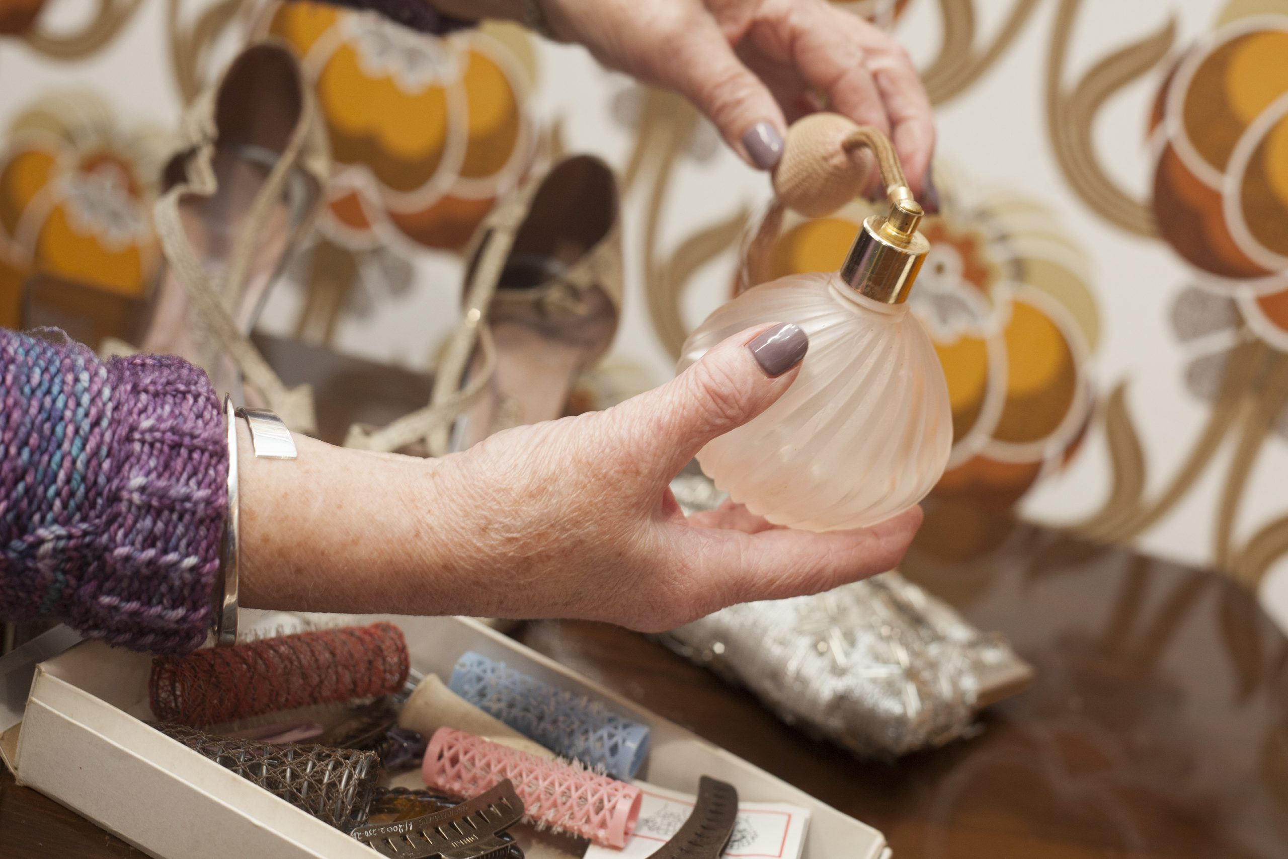Close up of a woman'shands holding a perfume bottle