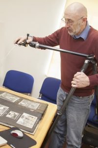 A man photographing archives with a camera in a stand