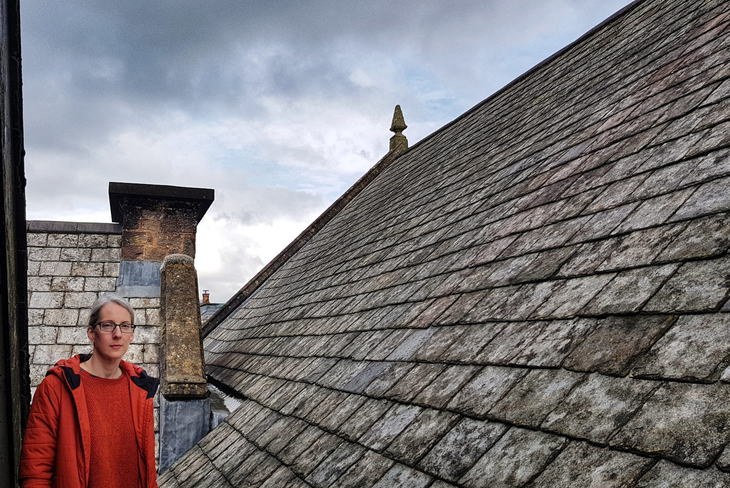 A woman standing on the roof of the museum