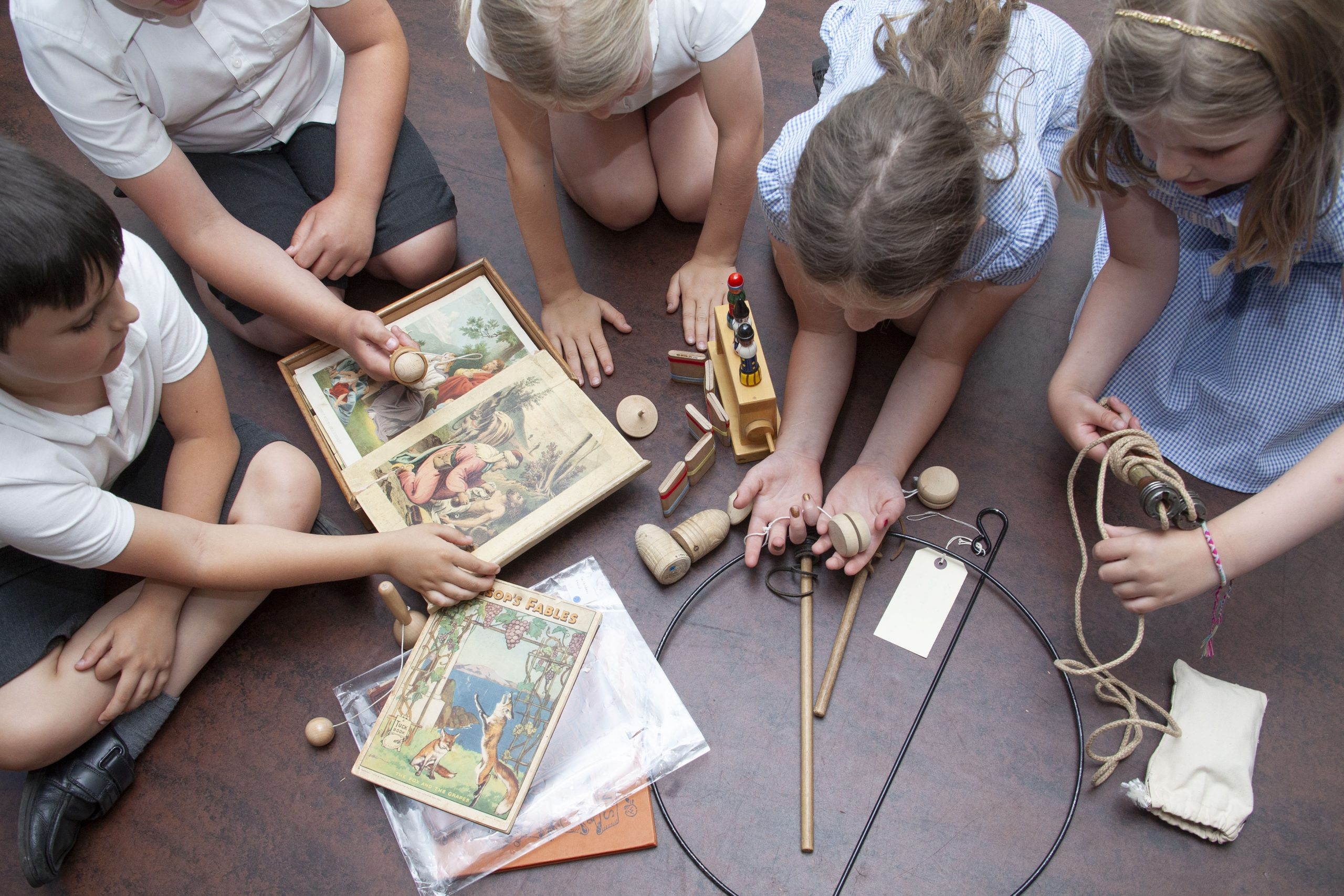 Children playing with museum objects