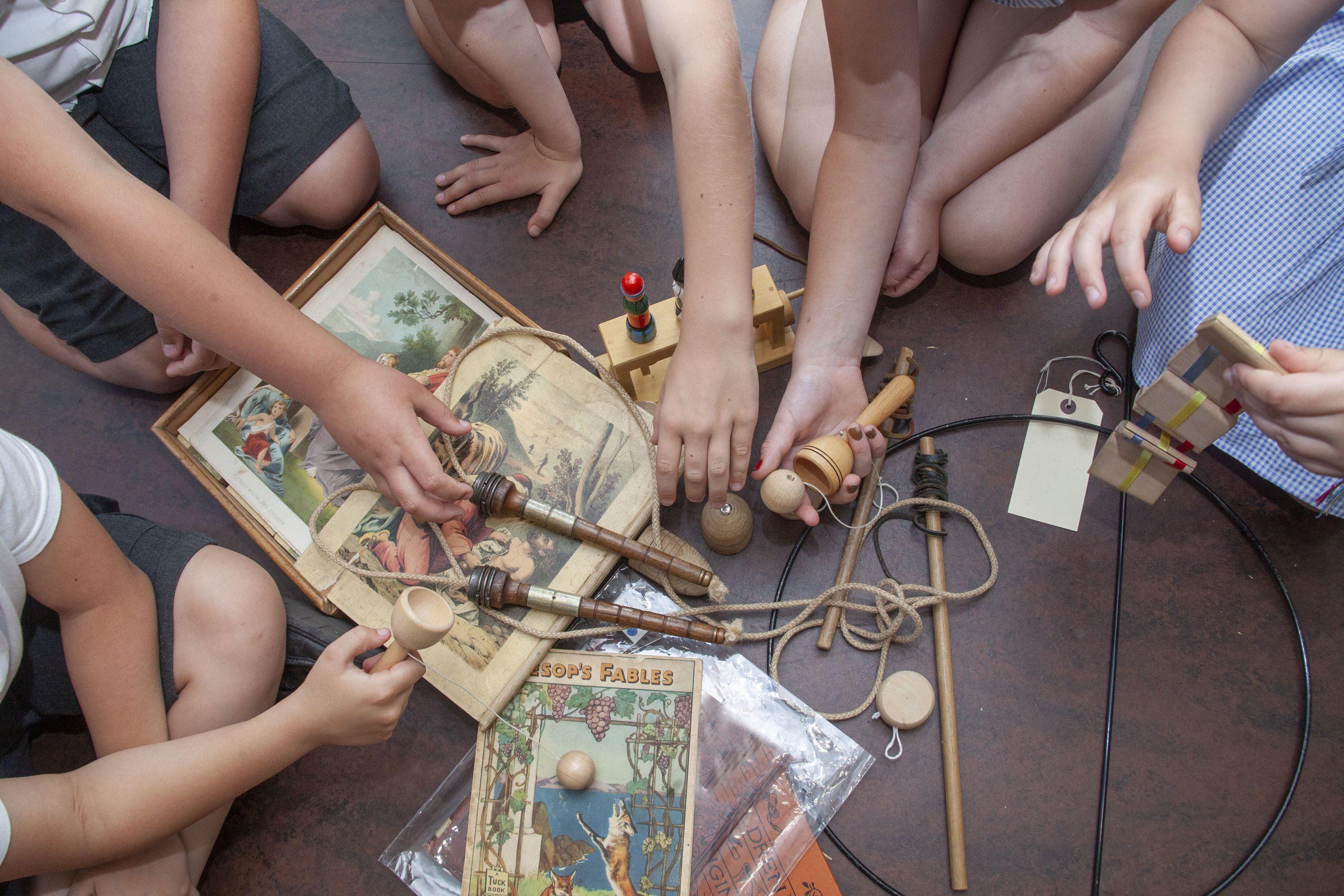 Children holding old toys