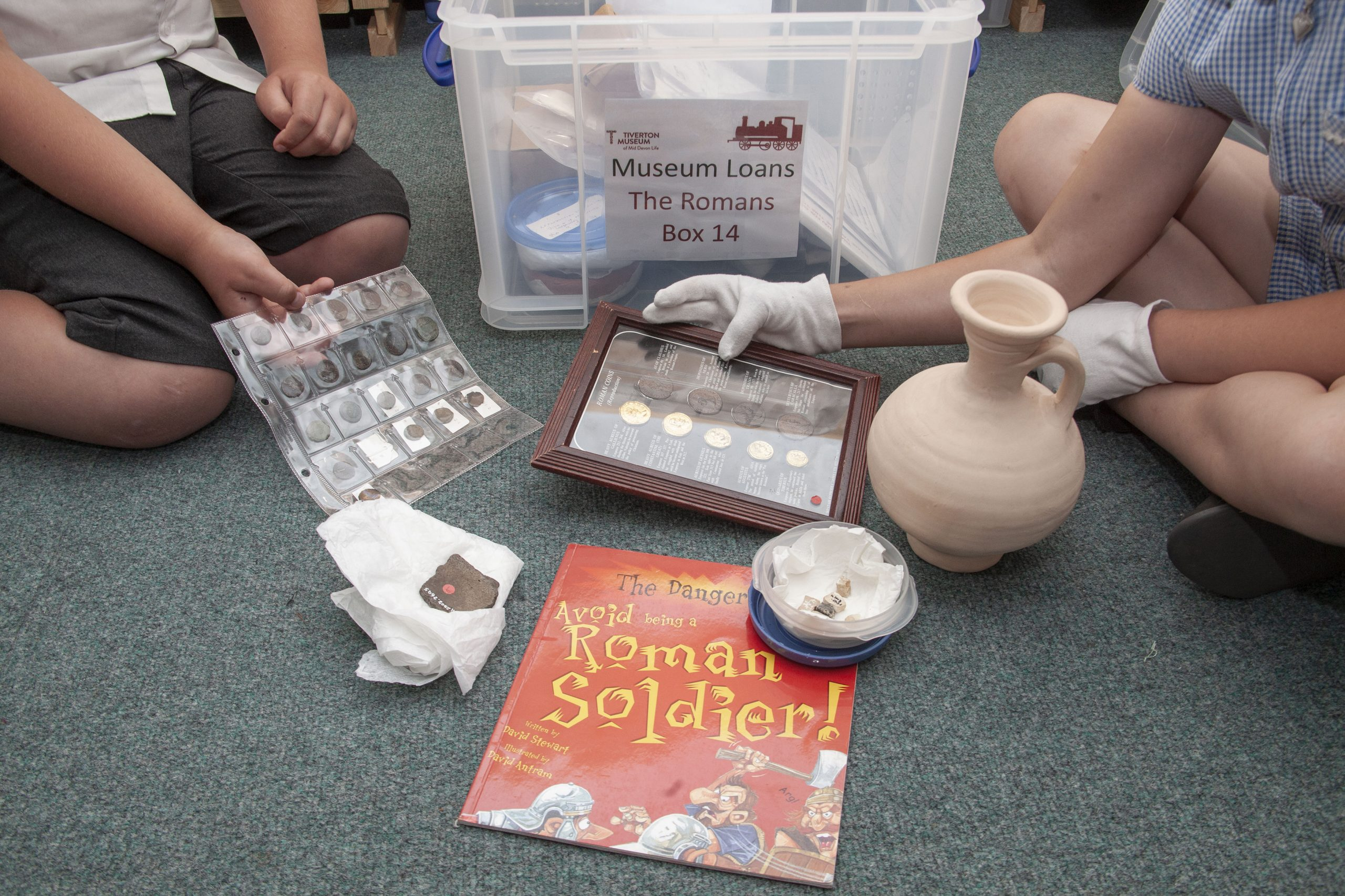 Children looking at a museum loan box