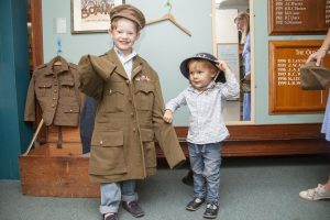 Two boys in dressing up clothes